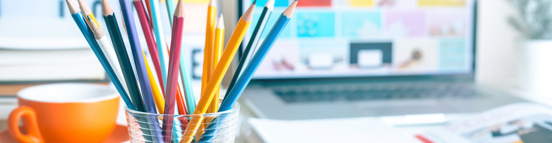 Colorful pencil in glass on desk table in home office.business creativity ideas